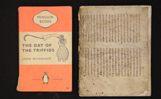D.20.54 next to a Penguin paperback