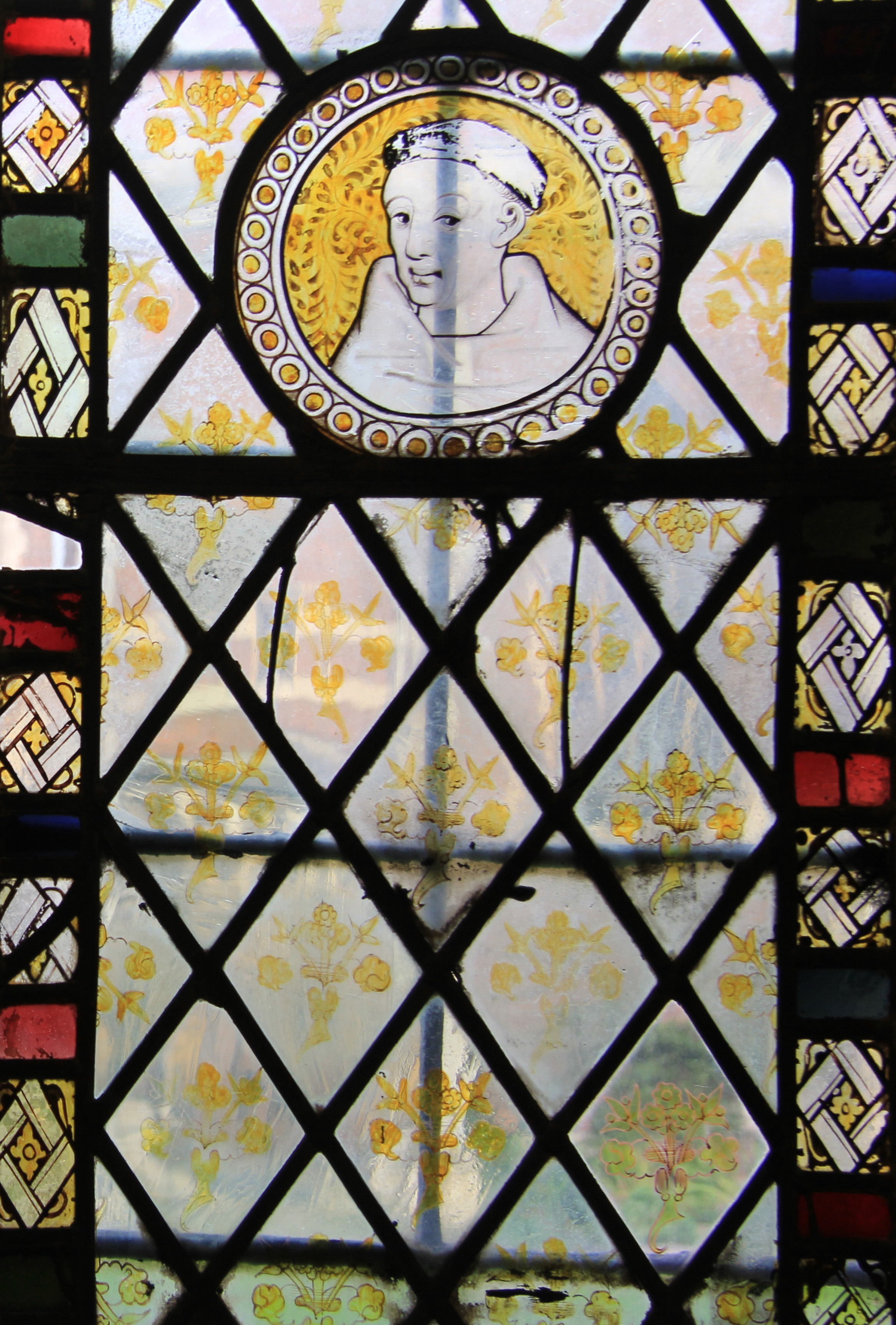 A Pre Reformation Medieval Stained Glass Carmelite Friar Watches Over The Old Library