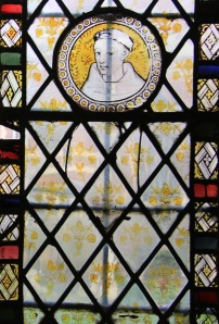 A pre-Reformation medieval stained glass Carmelite friar watches over the Old Library.